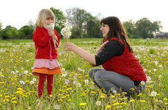 Mother and daughter on a meadow Royalty Free Stock Image