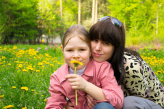 Mother and the daughter on meadow. Mother and the daughter on a green meadow with dandelions Stock Photography