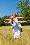 Mother with daughter in meadow Royalty Free Stock Images