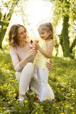 Mother and daughter in the meadow with ice cream. stock photography