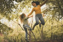Mother and daughter on meadow. Stock Images