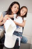 Mother and Daughter Measuring Ingredient Royalty Free Stock Photos