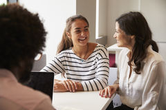 Mother And Daughter Meeting With Male Teacher Stock Photography