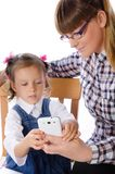 Mother and daughter with mobile phone Stock Image