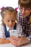 Mother and daughter with mobile phone Royalty Free Stock Photos