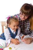 Mother and daughter with mobile phone Stock Photo