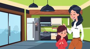 Mother And Daughter In Modern Kitchen Over Fridge And Stove Background Stock Photography