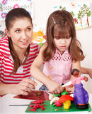 Mother and the daughter mould from plasticine. Royalty Free Stock Photography