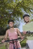 Mother And Daughter With Mountain Bikes Stock Photos