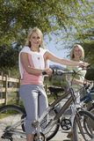 Mother And Daughter With Mountain Bikes Stock Photo