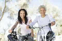 Mother And Daughter With Mountain Bikes Royalty Free Stock Images