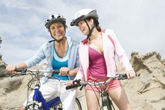 Mother And Daughter With Mountain Bikes Royalty Free Stock Image