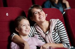 Mother with daughter in the movie Stock Image
