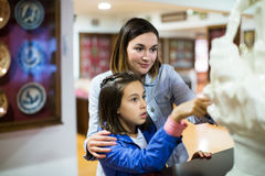 Mother and daughter in museum Stock Image