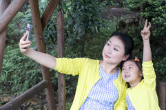 Mother and daughter in nature. Royalty Free Stock Image