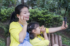 Mother and daughter in nature. Royalty Free Stock Photos