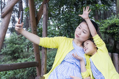 Mother and daughter in nature. Stock Photos
