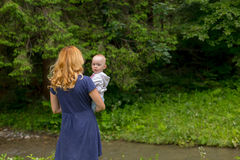 Mother and daughter in nature Stock Images
