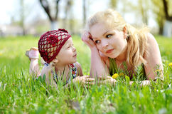 Mother and daughter on nature stock images