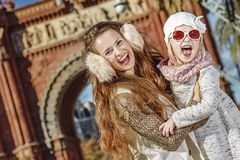 Mother and daughter near Arc de Triomf in Barcelona, Spain. In Barcelona for a perfect winter. cheerful modern mother and daughter near Arc de Triomf in Royalty Free Stock Photography