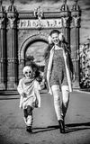 Mother and daughter near Arc de Triomf in Barcelona walking. In Barcelona for a perfect winter. Full length portrait of smiling trendy mother and daughter near Stock Photography