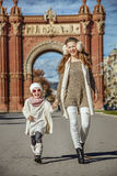 Mother and daughter near Arc de Triomf in Barcelona walking Stock Photography
