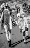 Mother and daughter near Arc de Triomf in Barcelona walking. In Barcelona for a perfect winter. happy trendy mother and daughter near Arc de Triomf in Barcelona Royalty Free Stock Image