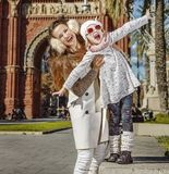 Mother and daughter near Arc de Triomf having fun time Stock Photo