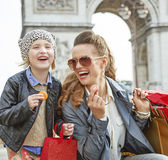 Mother and daughter near Arc de Triomphe eating macaroons Royalty Free Stock Image