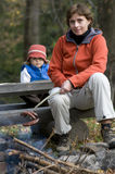 Mother and daughter near campfire Stock Images