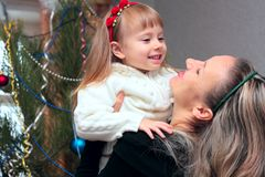 Mother and daughter near the Christmas Tree Royalty Free Stock Image
