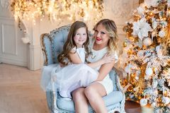 Mother and daughter near a Christmas tree Royalty Free Stock Image