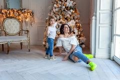 Mother and daughter near a Christmas tree Stock Photography