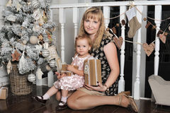 Mother and daughter near Christmas tree Stock Photo