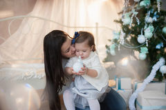 Mother and daughter near a Christmas tree, holiday, gift, decor, new year, christmas, lifestyle Royalty Free Stock Photography