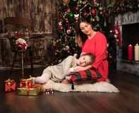 Mother and daughter near christmas tree Royalty Free Stock Images