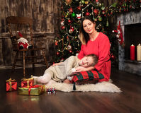 Mother and daughter near christmas tree Royalty Free Stock Image