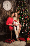 Mother and daughter near christmas tree Royalty Free Stock Photo