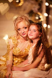 Mother and daughter near Christmas tree Stock Photography