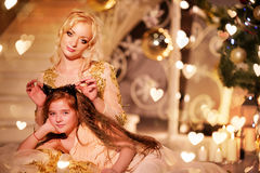 Mother and daughter near Christmas tree Stock Photos