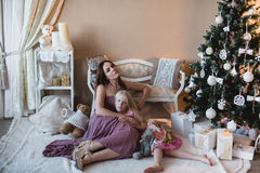 Mother and daughter near the Christmas tree, hugging, preparation for Christmas, decoration, decor, lifestyle, family, family valu Stock Photography