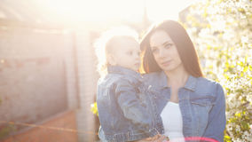 Mother and daughter near a flowering tree Royalty Free Stock Photo