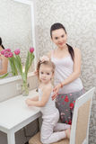 Mother and daughter near mirror Royalty Free Stock Images