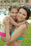 Mother with daughter  near pool Royalty Free Stock Images
