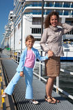 Mother daughter near ship in port royalty free stock images