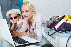 Mother with daughter near suitcase with credit card Royalty Free Stock Image