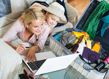 Mother with daughter near suitcase with credit card Stock Photos