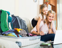 Mother with daughter near suitcase with credit card Stock Photography
