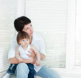 Mother and daughter near window Royalty Free Stock Image