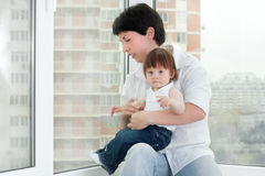 Mother and daughter near window Royalty Free Stock Images